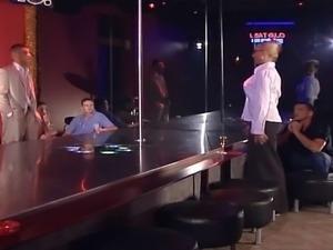 Hot stripper dances in a club, she dances so good that everyone around gets...