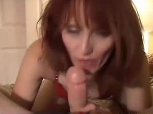 Older redhead is feeling horny so she sucks and fucks a lucky guy who cannot...