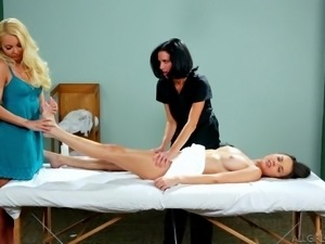 two girls massage their girlfriend