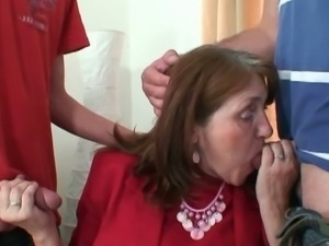 Hot granny shagged at the office by two young guys