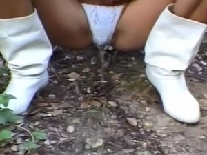 Kinky amateur bitch likes to pee outdoor.
