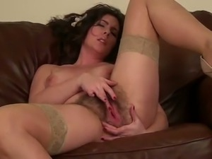 Horny brunette cougar plays with her hairy cunt