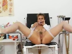 Old lady head nurse kinky hairy pussy spreading.