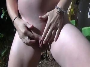 Im 8 months pregnant sunbathing in my garden caressing my big belly enjoy...