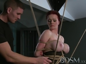 Teen redhead slave girl is suspended after epic blow job as Master fingers...