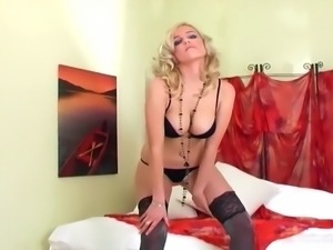 Blonde masturbates in thigh highs and high heels