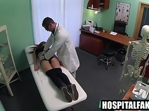 Foxy blonde patient getting massaged by her doctor