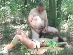 Teen jerks an dude's cock in the woods