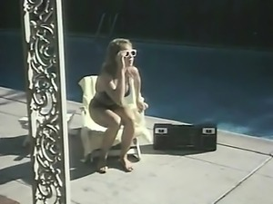 Traci Lords first seen standing in the nude as she towels