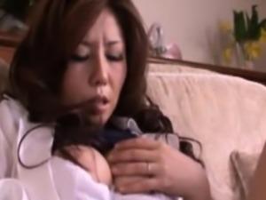 Busty mature asian milf fingers her clit