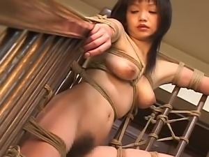 Japanese girl suspended and burned with hot wax
