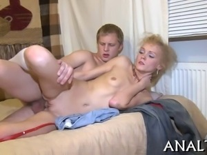Demure chick is moaning wildly as hunk pounds her anal canal