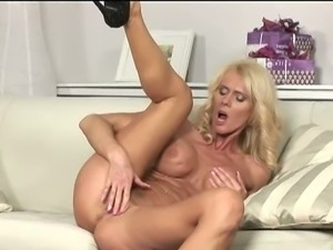 Busty mom masturbates solo on couch