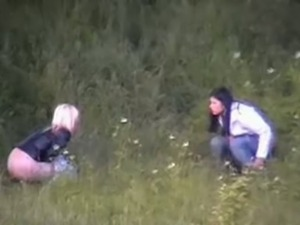 Ladies pissing outdoors get caught on hidden cam.