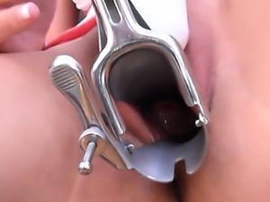 Brunette babe using huge gyno dildos