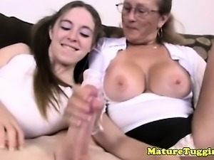MILF jerking lovers pampering cock