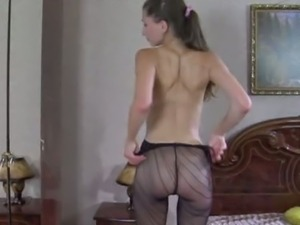 Juliet teases with a pair of patterned nylons