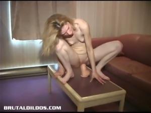 Skinny blonde teen sits on huge toy
