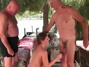 Young girl fucks two grandpas outdoor