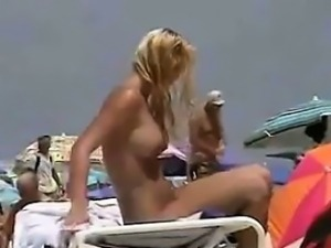 Naked Girl With Big Tits On The Beach