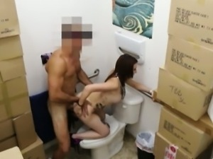 Busty tattooed chick fucked in pawnshops toilet