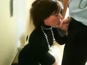 Cute woman doing a blowjob in the office