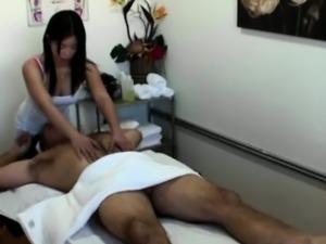 Asian masseuse toying with cock of her lucky customer