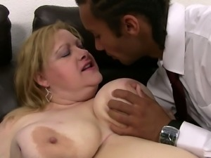 Huge blonde woman rides a nice black cock