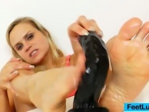 Naughty blonde poses and plays with a dildo