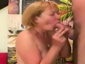 Redhead granny sucks a young meatbone and gets pounded