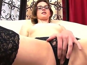Topless glassed girl Jay Taylor in black nylons and crotchless panties rubs...