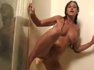 Horny cougar Joann Adams dildo fucking her pussy.