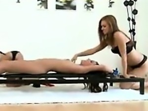 Tied Down Beauty In A Threesome With Toys