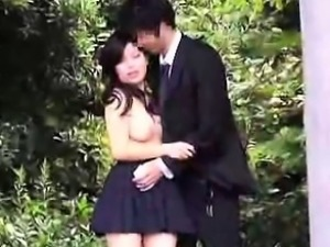 Pretty Asian schoolgirl having sex with her boyfriend in th