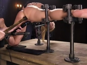 Every hole of this blonde is stuffed, when she is tied up in the dungeon by...