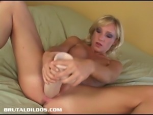 Blonde with big tits slides her pink pussy over a huge dildo