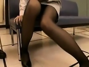 Asian hottie in nylons gives him a footjob and sits on his