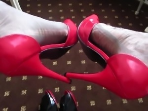 red heels in a baroque hotel room