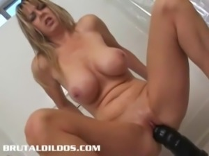 Busty cougar Heather fills her pussy with a giant dildo