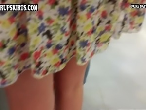 Lady in light summer dress upskirt