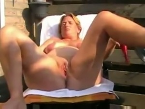 Slutty light haired amateur wifey of my neighbor masturbates on veranda