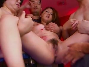 Japanese beauty gets two dicks filling her holes