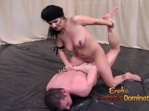Nude woman struggling against her naked male opponent