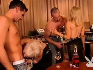 busty blonde having fun with dudes