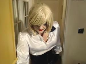 Kandy secretary style satin blouse and shiny PVC skirt