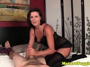 Handjob milf in stockings tugging hard cock